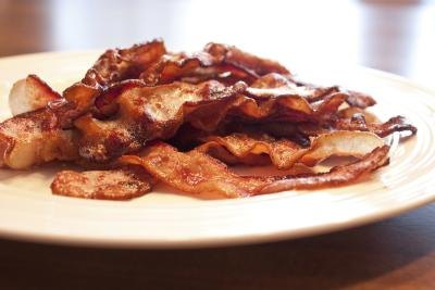Saturated fat in foods like bacon raises bad cholesterol levels.