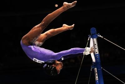 Gabby Douglas on uneven bars