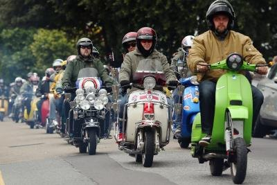 Scooter riders at festival