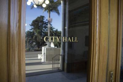 A close-up of the front door of a city hall.