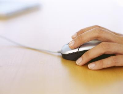 Woman clicking screen with mouse