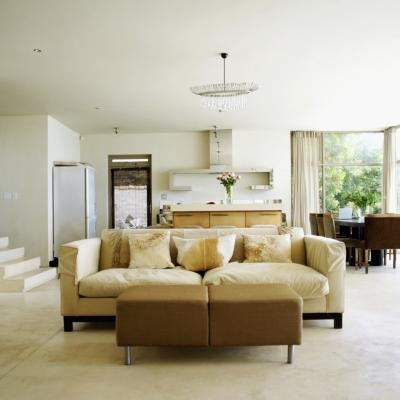 A couch is placed in the center of a room - Open floor plan furniture layout ideas ...