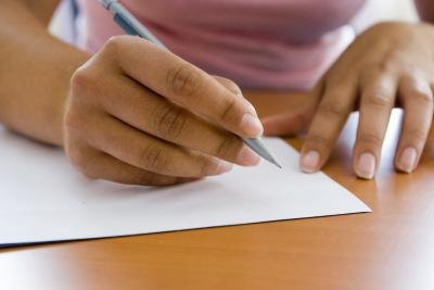 Young woman writing an article.