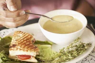 Many lunch specials offer a cup of soup and one-half sandwich as part of their light menu.