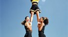 How to Improve Strength for a Girl Cheerleader