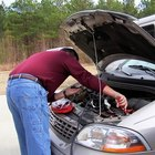 Man checking battery in car