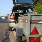 A utility trailer is designed for use with a small truck or car.