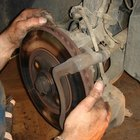 Brake pads clamp against the brake rotor to slow the rotation of the wheel.