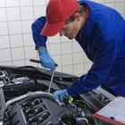 Close-up of a mechanic working on a car engine