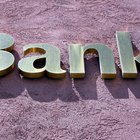 What Are the Differences Between Commercial Banks & Thrift Institutions?
