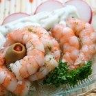 ¿Es la carne del cangrejo y del camarón alta en colesterol?