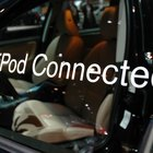 An FM transmitter will let you play audio on your iPhone through your car radio.