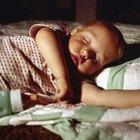 Cómo evitar que un niño se caiga de la cama