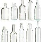 Cómo taladrar un agujero en una botella de vidrio vacía