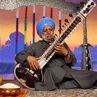 Cómo afinar un sitar con notas occidentales equivalentes