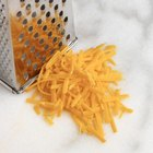 How Many Calories are in Half-Cup of Shredded Cheese?
