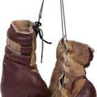 ¿Cuánto pesan los guantes que se utilizan en una pelea profesional de boxeo en la categoría peso pesado?