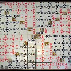 Homemade sequence board game using playing cards