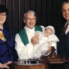 What happens in an infant baptism ceremony?