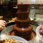 How much oil should one use in a chocolate fountain?