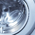 How to remove sludge from the drain holes of a washing machine