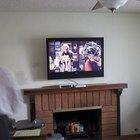 Ideias para lareiras com televisão acima