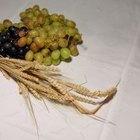 O que significa o trigo com uvas em um arranjo floral
