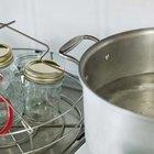 ¿Qué elimina el residuo negro de las ollas de acero inoxidable?