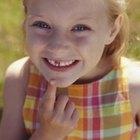 Cómo tirar del diente flojo de un niño