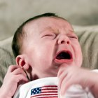 How do deaf people know if a baby is crying?
