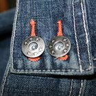 How to remove the waist button on my jeans