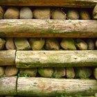 Como construir um muro de arrimo com madeira de paisagismo