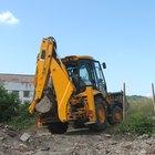 Como remover pedras de terreno escavado