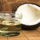 A jar of coconut oil on a wooden table