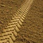 Herramientas de jardinería para compactar la tierra suelta