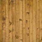 Cómo colocar paneles de madera en una pared