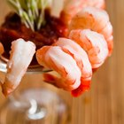 Shrimp cocktail served in stem glass