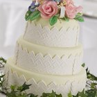 Wedding cake with glaze an eadible silver and flowers