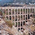 Os estágios de construção de um aqueduto romano
