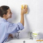 Use a clean damp sponge to remove excess grout from the tile.