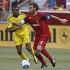 Em qual posicionamento de futebol o jogador corre mais?