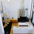 Cómo instalar un tubo de chimenea en una estufa a leña a través de una pared