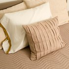 How Can I Soften a New Pillow That Is Stiff?