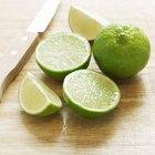 lemonade with fresh slice lemon on wooden background