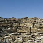 A dry-laid stone wall takes some practice but produces lasting results.