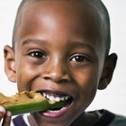 Little boy eating a healthy lunch at school