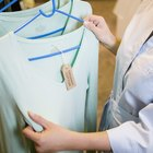 Man browsing through rack of shirts