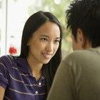 Asian woman telling boyfriend a secret