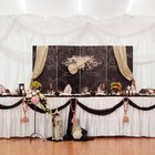 Wedding Party Top Table With Floral Piece & Star Curtain