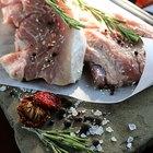 Fresh raw pork on cutting board on white background